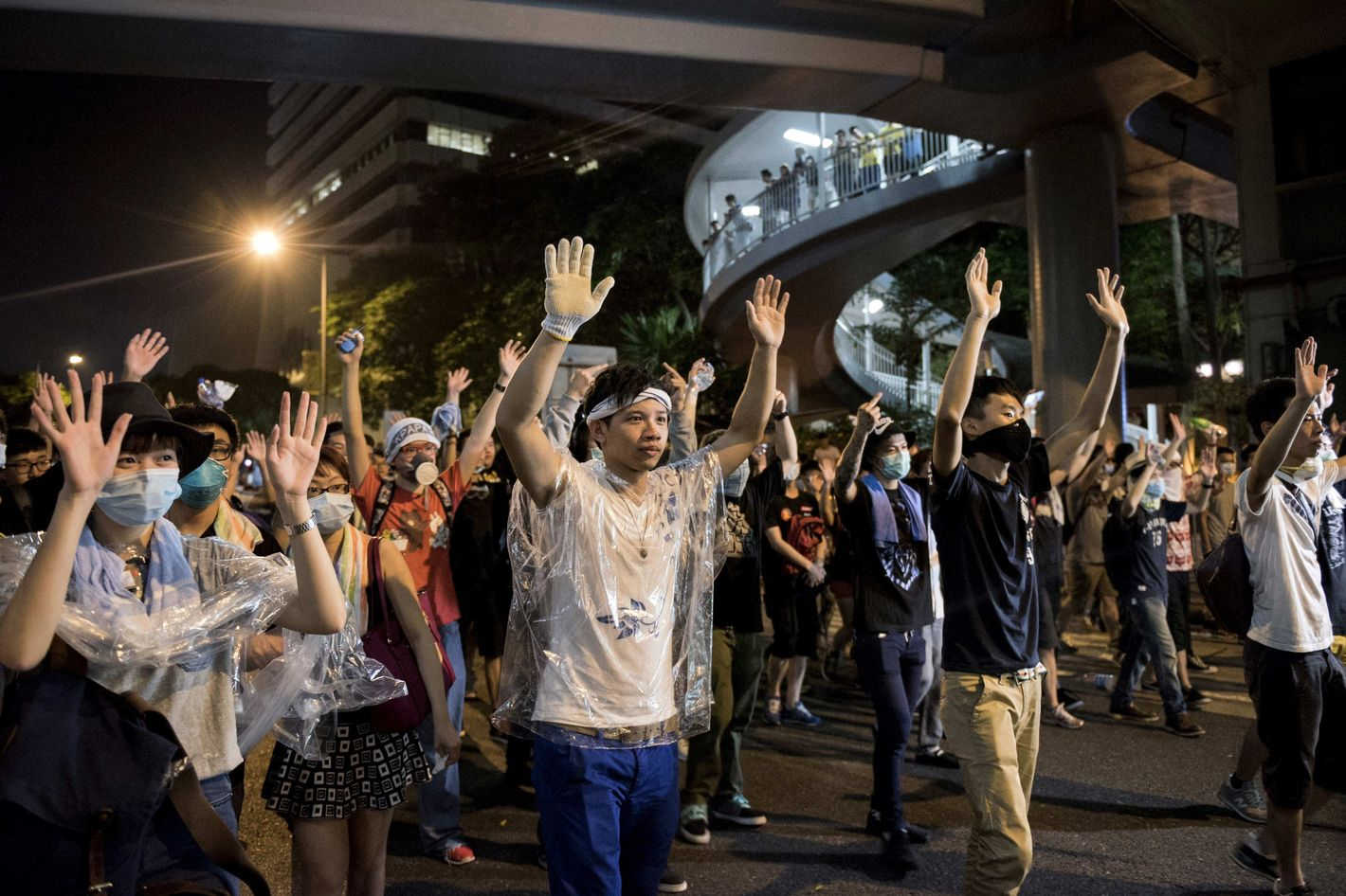 "Hong Kong protesters making ""hands up don't shoot"" gesture"